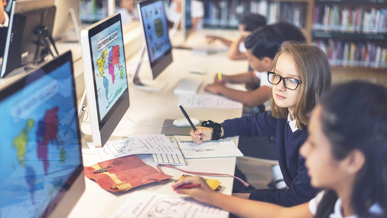 local school children using computer