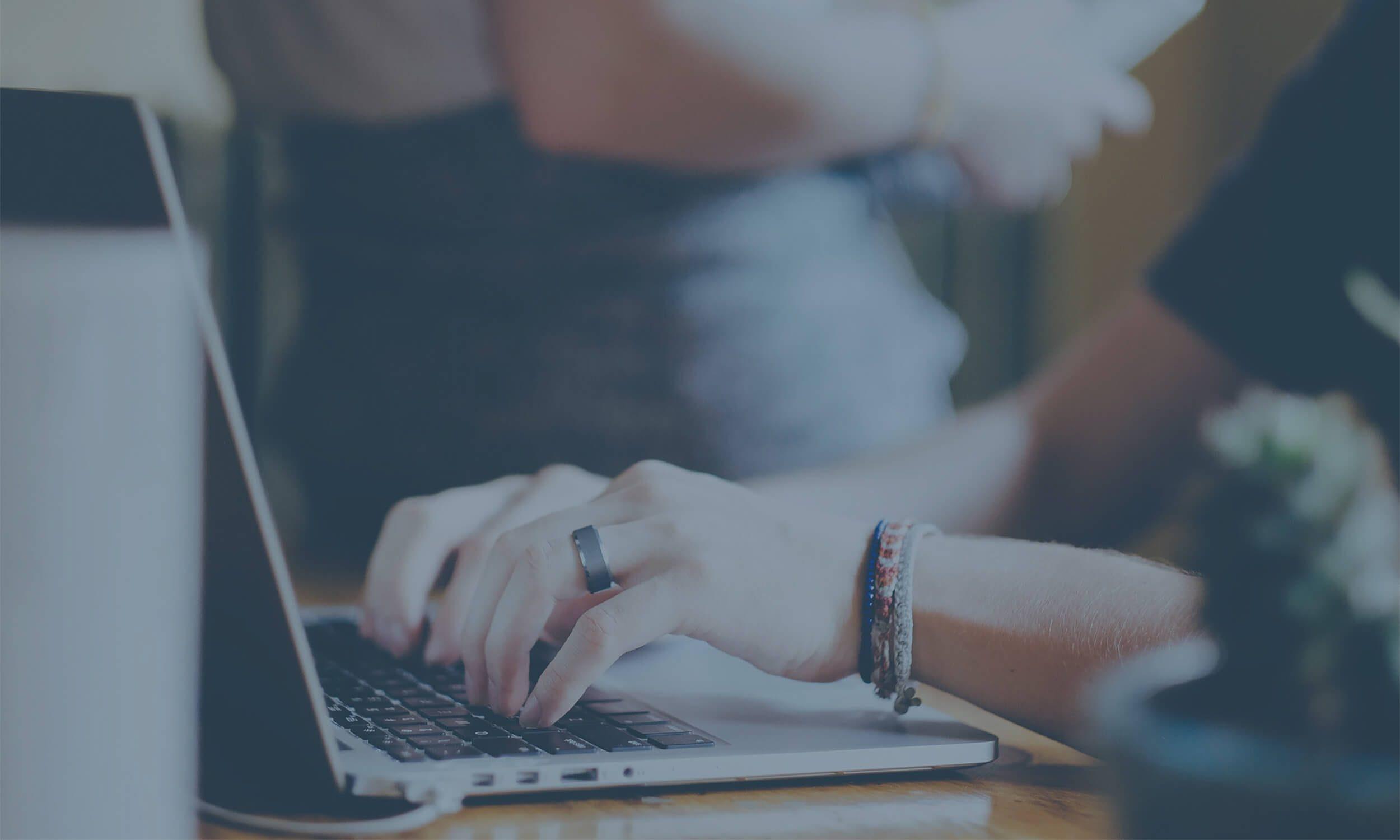 recruiter using software on laptop