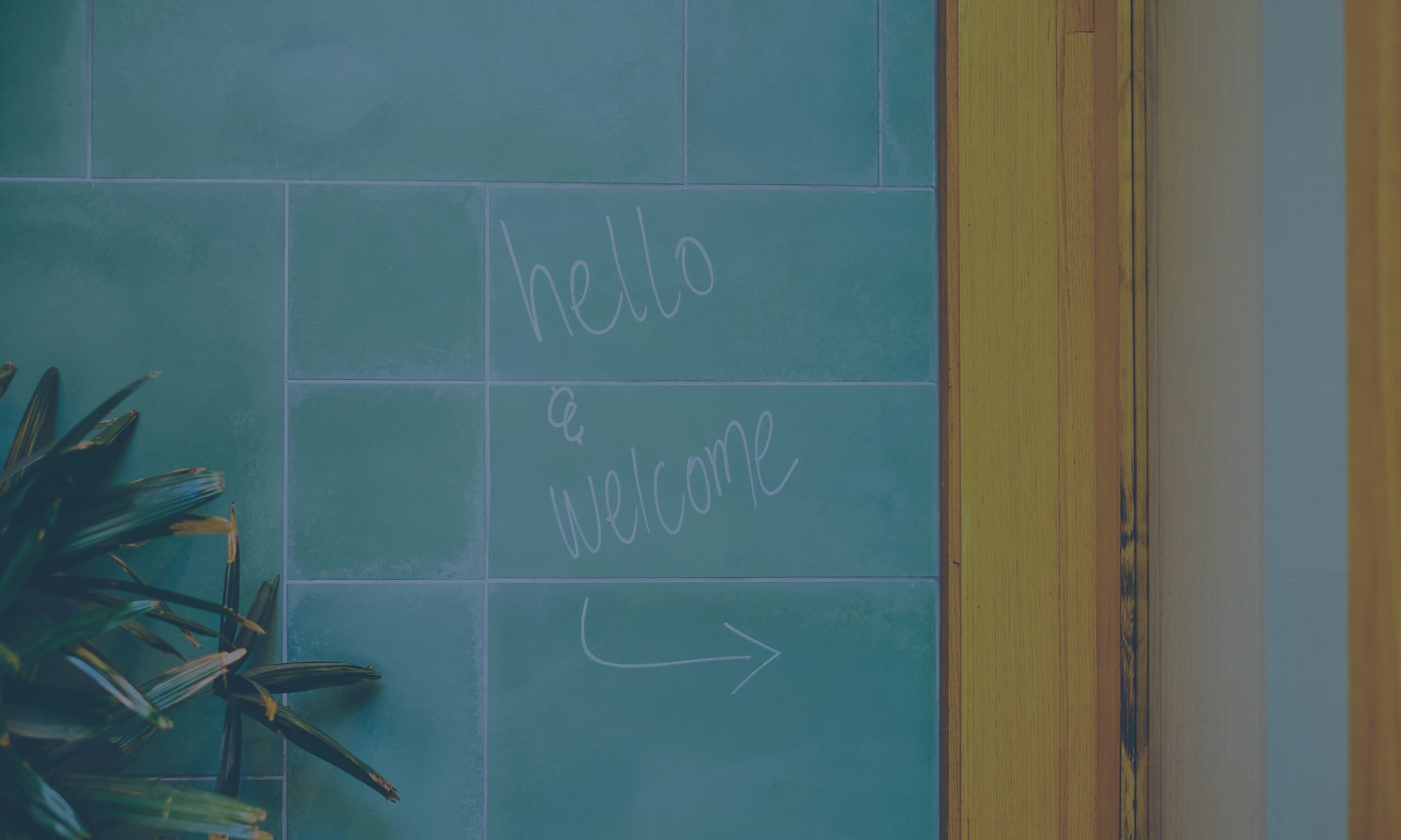 hello and welcome writing on office wall